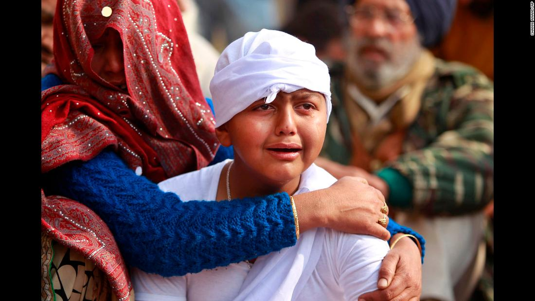 "The son of Indian civilian Gopal Dass, who was killed during reported clashes between Indian and Pakistani soldiers, cries in the village of Jhiri in the region of Jammu and Kashmir State, India, on Monday, January 22. <a href=""https://apnews.com/f9f276f7f4f249e2a5514cdd8d514960/India,-Pakistan-continue-trading-fire-and-blame-in-Kashmir"" target=""_blank"">According to the Associated Press</a>, ""Indian and Pakistani soldiers again targeted each other's posts and villages along their volatile frontier in disputed Kashmir after a day's lull, killing at least one civilian and wounding three others, officials said Monday."" India and Pakistan have been <a href=""https://www.cnn.com/2013/11/08/world/kashmir-fast-facts/index.html"" target=""_blank"">fighting over Kashmir</a> since both countries gained their independence in 1947."