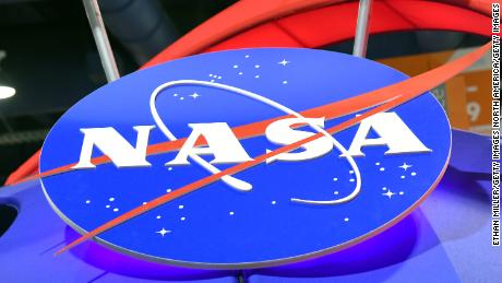 LAS VEGAS, NV - JANUARY 11:  The NASA logo is displayed at the agency's booth during CES 2018 at the Las Vegas Convention Center on January 11, 2018 in Las Vegas, Nevada. CES, the world's largest annual consumer technology trade show, runs through January 12 and features about 3,900 exhibitors showing off their latest products and services to more than 170,000 attendees.  (Photo by Ethan Miller/Getty Images)