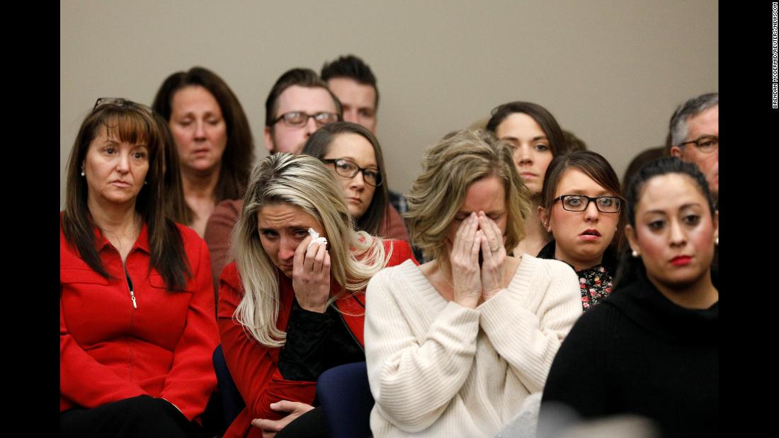 "People react in the courtroom as Rachael Denhollander, not pictured, speaks during the sentencing hearing of Larry Nassar -- the former osteopathic sports physician with USA Gymnastics and Michigan State University -- in Lansing, Michigan, on Wednesday, January 24. Denhollander, a former gymnast who is credited with helping to shine a light on Nassar's abuse, was the last of <a href=""http://www.cnn.com/2018/01/24/us/they-helped-serve-larry-nassar-justice/index.html"" target=""_blank"">more than 150 women and girls to confront Nassar in court</a> during his sentencing hearing. Circuit Court Judge Rosemarie Aquilina <a href=""https://www.cnn.com/2018/01/24/us/larry-nassar-sentencing/index.html"" target=""_blank"">sentenced Nassar to 40 to 175 years for his decades of sexual abuse</a>."