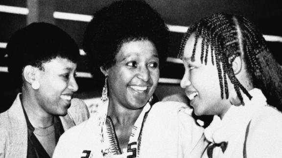Madikizela-Mandela and her two daughters -- Zenani, left, and Zindzi -- arrive at Cape Town's airport to visit her imprisoned husband in 1985.