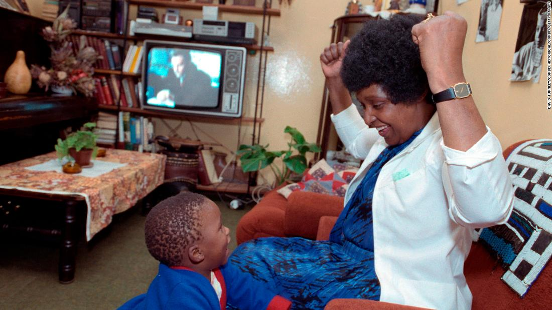 Madikizela-Mandela is pictured with her grandson in 1986.