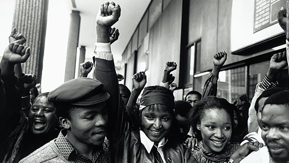 Madikizela-Mandela, center, celebrates alongside her daughter Zindzi and other supporters following her release from Johannesburg Magistrates Court. She had been arrested for defying a court order that banned her from entering Soweto, an area at the center of the anti-apartheid movement in Johannesburg.