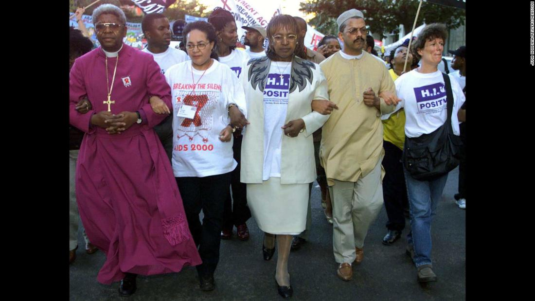 Madikizela-Mandela leads a protest march during an international AIDS conference in Durban, South Africa, in 2000.
