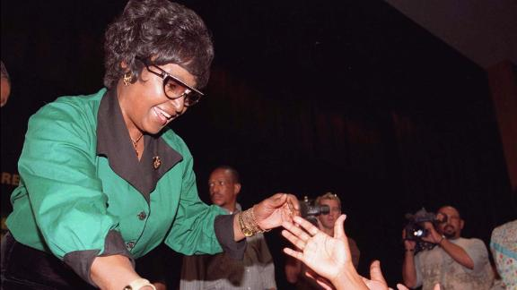 Madikizela-Mandela shakes hands with supporters in Rustenburg, South Africa, in 1997. She had just been elected president of the African National Congress Women's League.