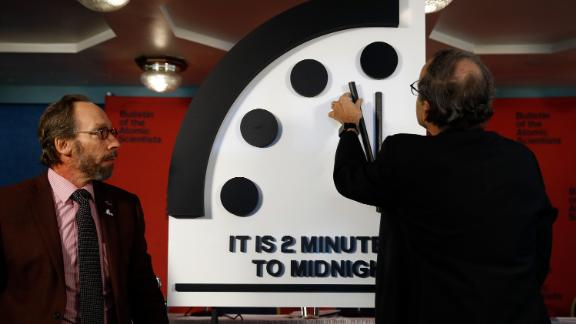 Robert Rosner, chairman of the Bulletin of the Atomic Scientists, right, joined by Bulletin of the Atomic Scientists member Lawrence Krauss, left, moves the minute hand of the Doomsday Clock to two minutes to midnight during a news conference at the National Press Club in Washington, Thursday, Jan. 25, 2018. ( AP Photo/Carolyn Kaster)