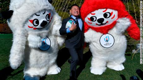TOKYO, JAPAN - JANUARY 26:  (C) Yasutaro Matsuki and Mascot Ren-G for the 2019 Rugby World Cup in Japan pose for photographs during the Rugby World Cup official mascot unveiling at Meiji Kinenkan on January 26, 2018 in Tokyo, Japan.  (Photo by Koki Nagahama/Getty Images)