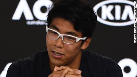 Hyeon Chung speaks to reporters.