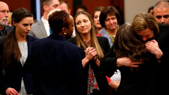 Rachael Denhollander and Kyle Stephens, two survivors of Larry Nassar's abuse, and others embrace at his sentencing.