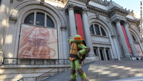 Teenage Mutant Ninja Turtle Michelangelo visited the Metropolitan Museum of Art to enjoy an exhibit of the other Michelangelo's work.