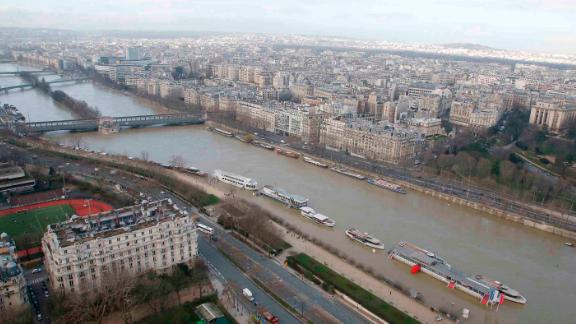 Record rainfall has caused the banks of the Seine river in Paris to overflow, flooding surrounding streets and causing travel disruptions.