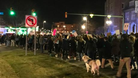 Hundreds of students march toward the MSU administration building on January 26.