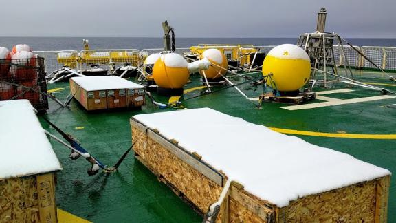 Boxes with underwater robots sit on the deck of an icebreaker on its way to Antarctica for research.