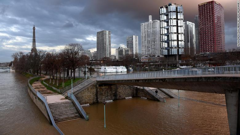 Views of the swollen Seine on Saturday in Paris, with the Eiffel Tower in the background at bottom.