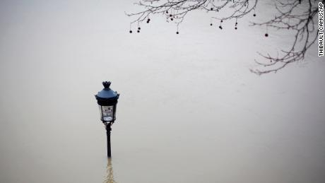 A street lamp is visible in floodwaters Saturday next to the Seine in Paris.
