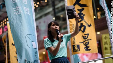 Pro-democracy Demosisto party member Agnes Chow speaks to passing pedestrians in Hong Kong on June 4, 2017.