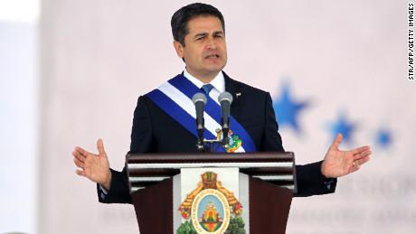 Reelected President Juan Orlando Hernandez gives a speech wearing the presidential sash during the inauguration ceremony at the Tiburcio Carias Andino national stadium, in Tegucigalpa, on January 27, 2018 Hernandez begins his second presidential term as the opposition vowed mass protests over claims he fraudulently won November elections.