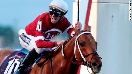 Jockey Florent Geroux celebrates as Gun Runner crosses the finish line to win the Pegasus World Cup Invitational horse race, Saturday, Jan. 27, 2018, at Gulfstream Park in Hallandale Beach, Fla. (AP Photo/Lynne Sladky)