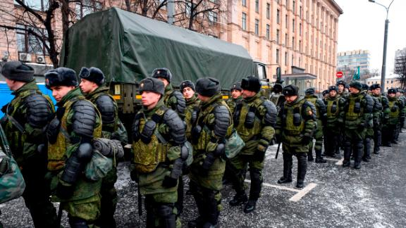 Service members gather at Triumfalnaya Square ahead of an opposition rally calling for a boycott of March 18 presidential elections.