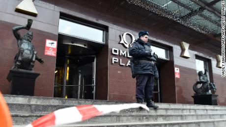 A Russian police officer stands outside Alexei Navalny's Moscow office on Sunday.