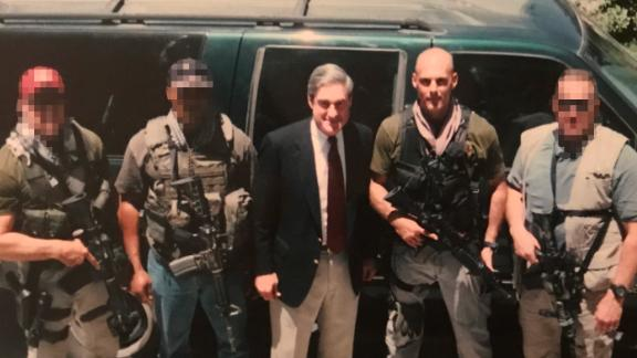 On a trip to Afghanistan in 2002, then-FBI agent James Gagliano served as a bodyguard to then-FBI director Robert Mueller, center, who later autographed the photo.