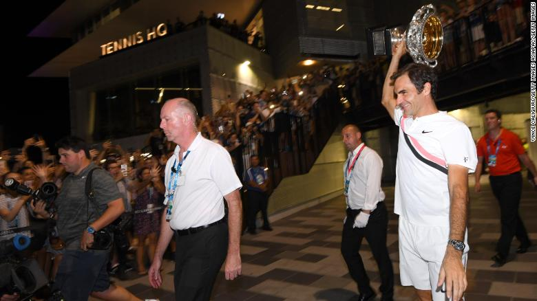 Roger Federer takes his trophy on a tour.