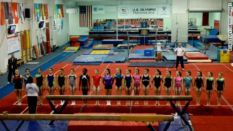 Gymnasts lined up before Martha Karolyi (in the white jacket) after their morning workout at the Karolyi Ranch in January 2011.