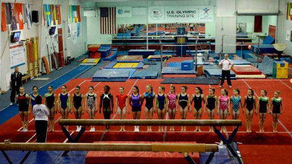 Gymnasts line up before Martha Karolyi, white jacket left, as they conclude their moring work session at Karolyi Ranch on January 26, 2011 in Huntsville, Texas.