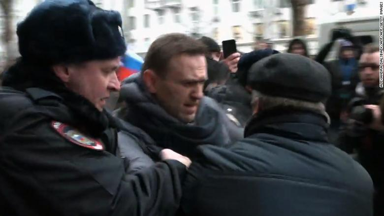 A still image taken from an AFPTV footage shows police officers detaining opposition leader Alexei Navalny during a rally calling for a boycott of March 18 presidential elections, Moscow, January 28, 2018.