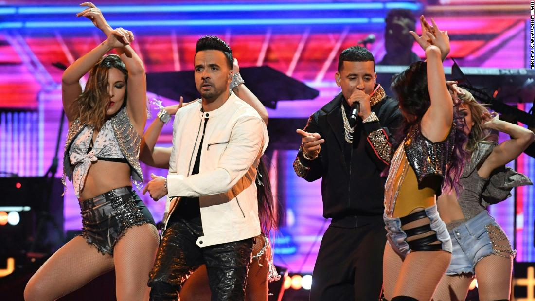 "Luis Fonsi and Daddy Yankee are joined by dancers for their hit song ""Despacito."""