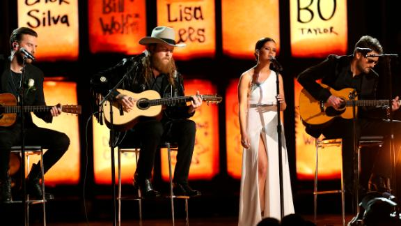 "The Brothers Osborne, left, join Maren Morris and Eric Church for a cover of the Eric Clapton classic ""Tears in Heaven."" The song -- and the stage -- paid tribute to those killed in the Las Vegas shooting last year."