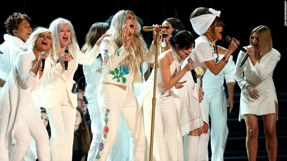 "Kesha performs ""Praying"" as she is backed up by singers including Bebe Rexha, Cyndi Lauper, Camila Cabello, Andra Day and Julia Michaels."