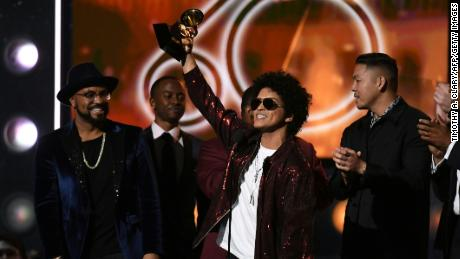Bruno Mars receives the Grammy for the Best Song of the year during the 60th Annual Grammy Awards show on January 28, 2018, in New York.  / AFP PHOTO / Timothy A. CLARY        (Photo credit should read TIMOTHY A. CLARY/AFP/Getty Images)