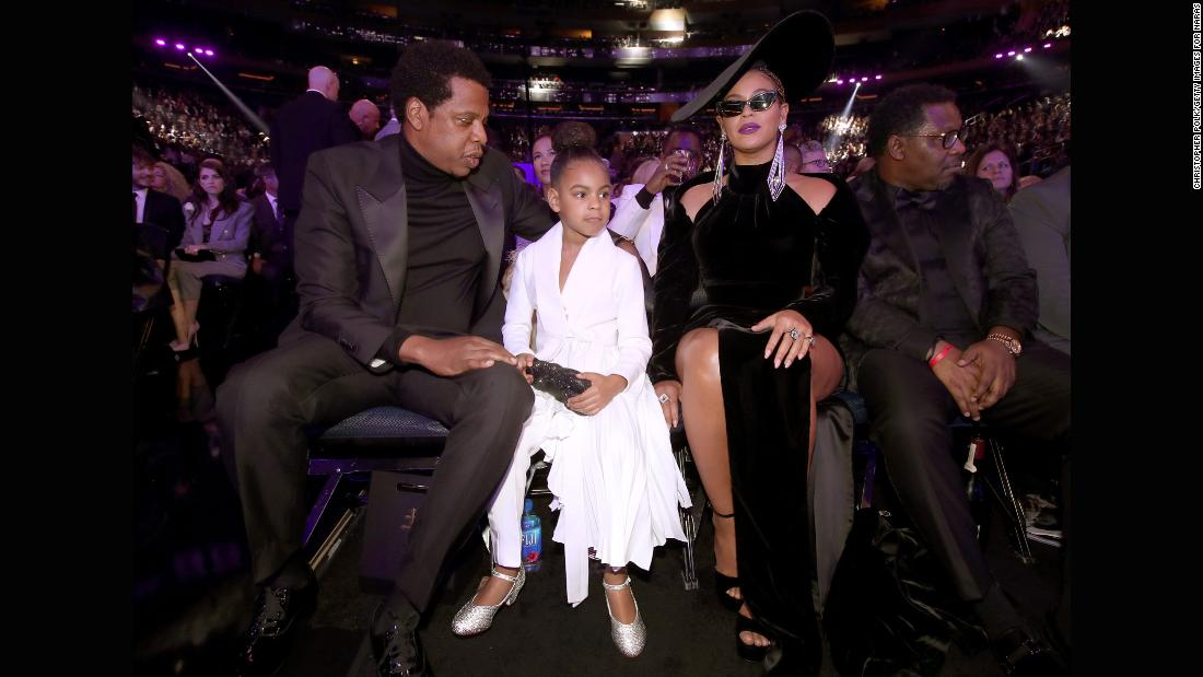 Jay-Z, Beyonce and their daughter Blue Ivy attend the show.