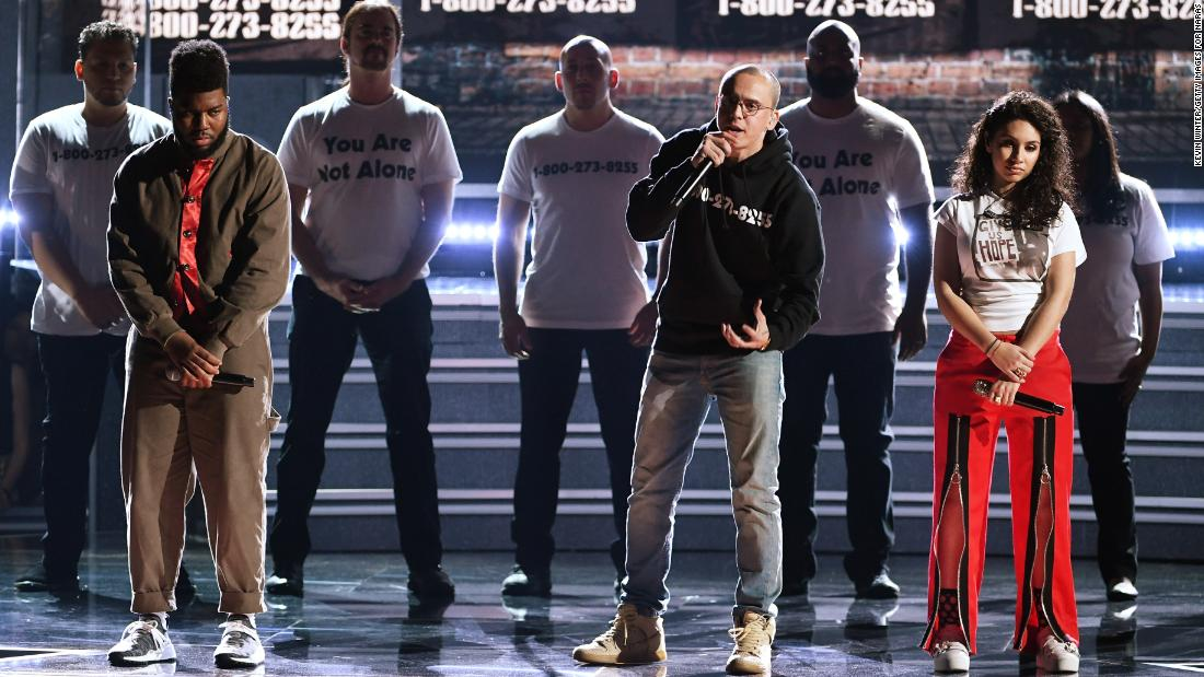 "From left, Khalid, Logic and Alessia Cara perform ""1-800-273-8255."" The song title is the phone number of the National Suicide Prevention Lifeline."