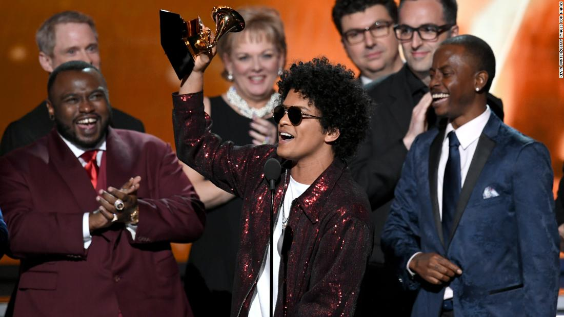"Bruno Mars accepts the Grammy Award for album of the year, which he won for ""24K Magic"" on Sunday, January 28. Mars also won the Grammys for song of the year (""That's What I Like"") and record of the year (""24K Magic"")."