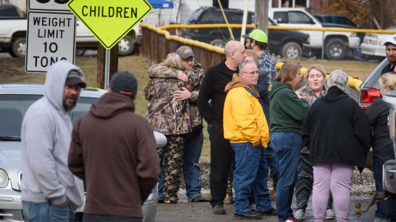 Family members,  friends console each other after four people are killed at a Pennsylvania car wash.