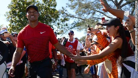 SAN DIEGO, CA - JANUARY 28:  Tiger Woods high fives a fan during the final round of the Farmers Insurance Open at Torrey Pines South  on January 28, 2018 in San Diego, California.  (Photo by Donald Miralle/Getty Images)