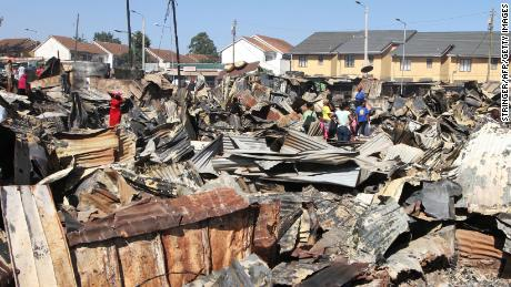 Residents of the Kijiji slum in Nairobi rummage through burnt debris following an inferno that left thousands of families homeless and four dead.