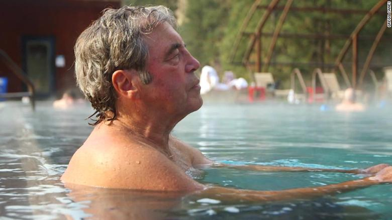 Don Benedict, 70, soaks in warm water fed by hot springs in Idaho City, Idaho.