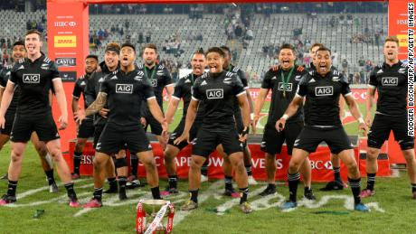 New Zealand's players celebrate with the trophy after winning the World Rugby Sevens Series at Cape Town Stadium on December 10, 2017 in Cape Town. / AFP PHOTO / RODGER BOSCH        (Photo credit should read RODGER BOSCH/AFP/Getty Images)