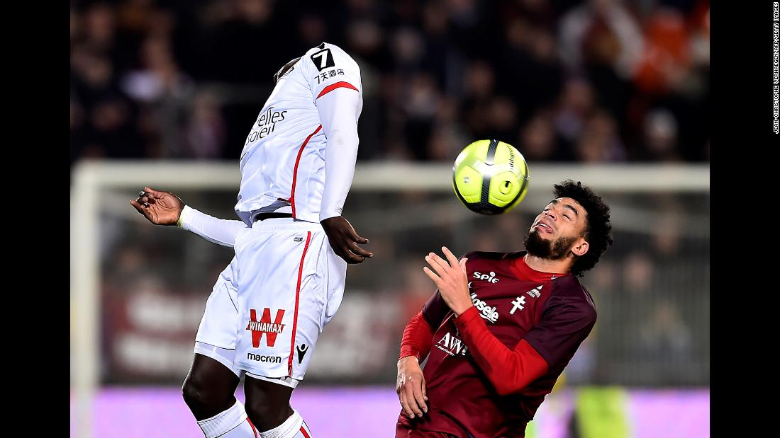 Metz forward Emmanuel Riviere, right, and Nice defender Racine Coly compete for the ball during a French league soccer match on Saturday, January 27.