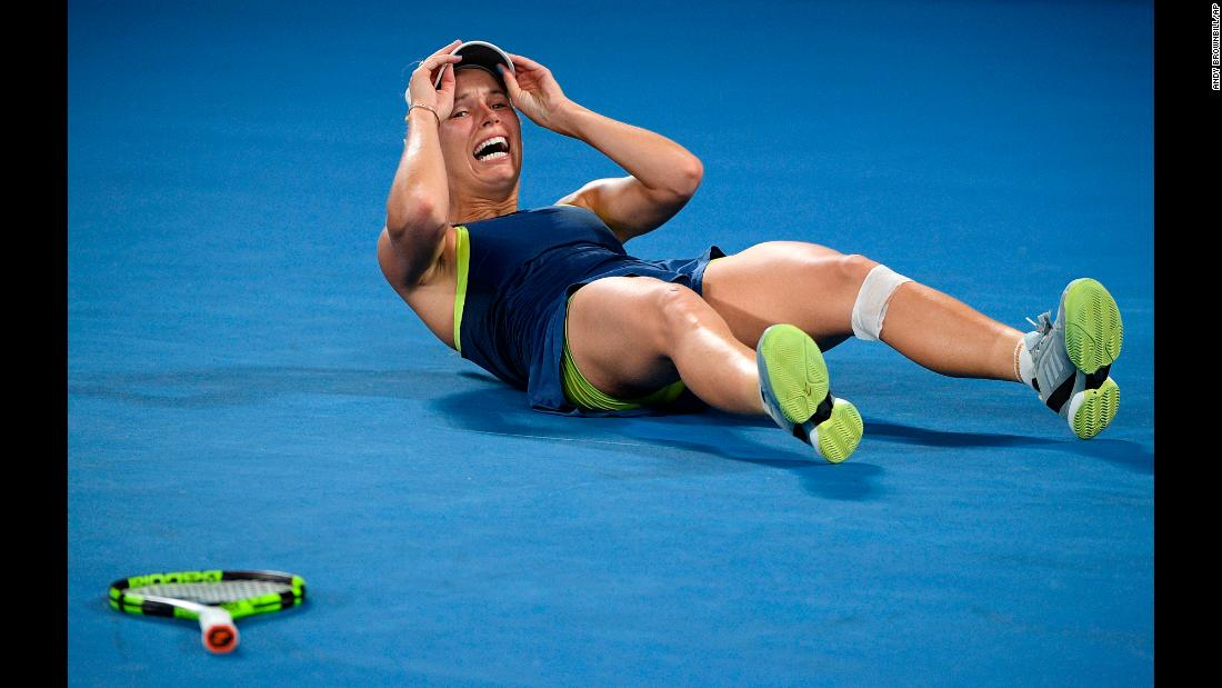 "Caroline Wozniacki falls to the ground after winning the Australian Open title on Saturday, January 27. It is the first major title for Wozniacki, <a href=""https://www.cnn.com/2018/01/27/sport/australian-open-halep-wozniacki-tennis/index.html"" target=""_blank"">who defeated Simona Halep in a three-set final</a> that lasted nearly three hours."