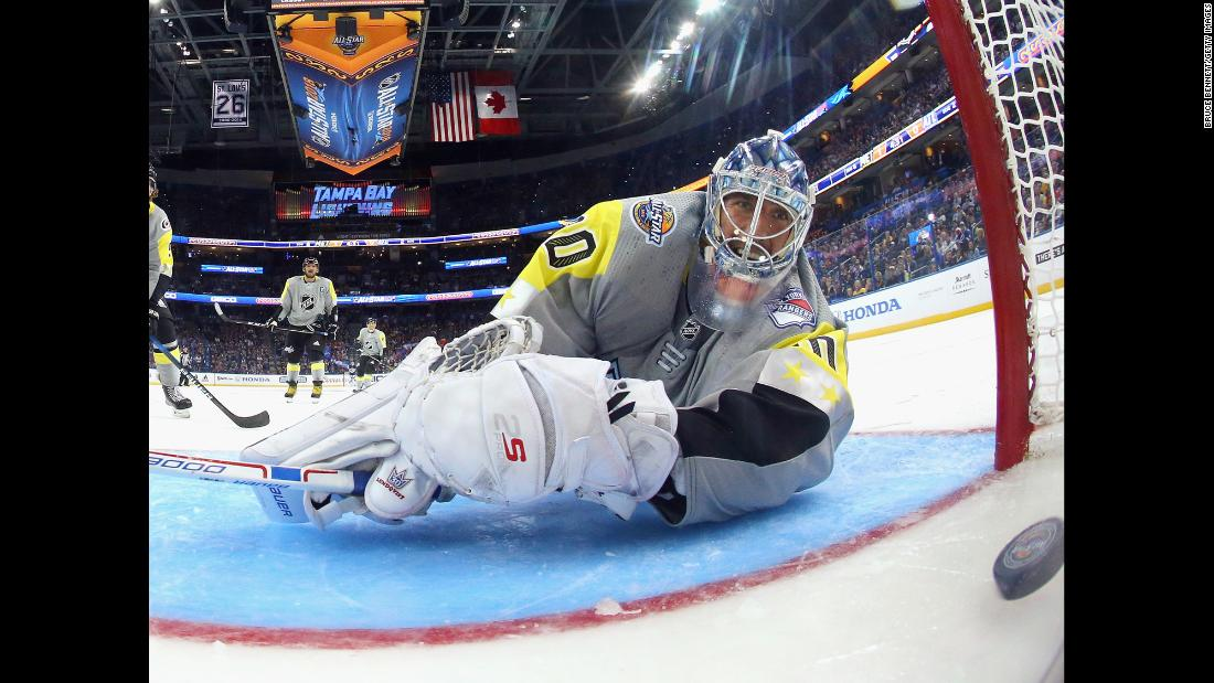 Goalie Henrik Lundqvist watches a puck go behind him during the NHL All-Star Game on Sunday, January 28.