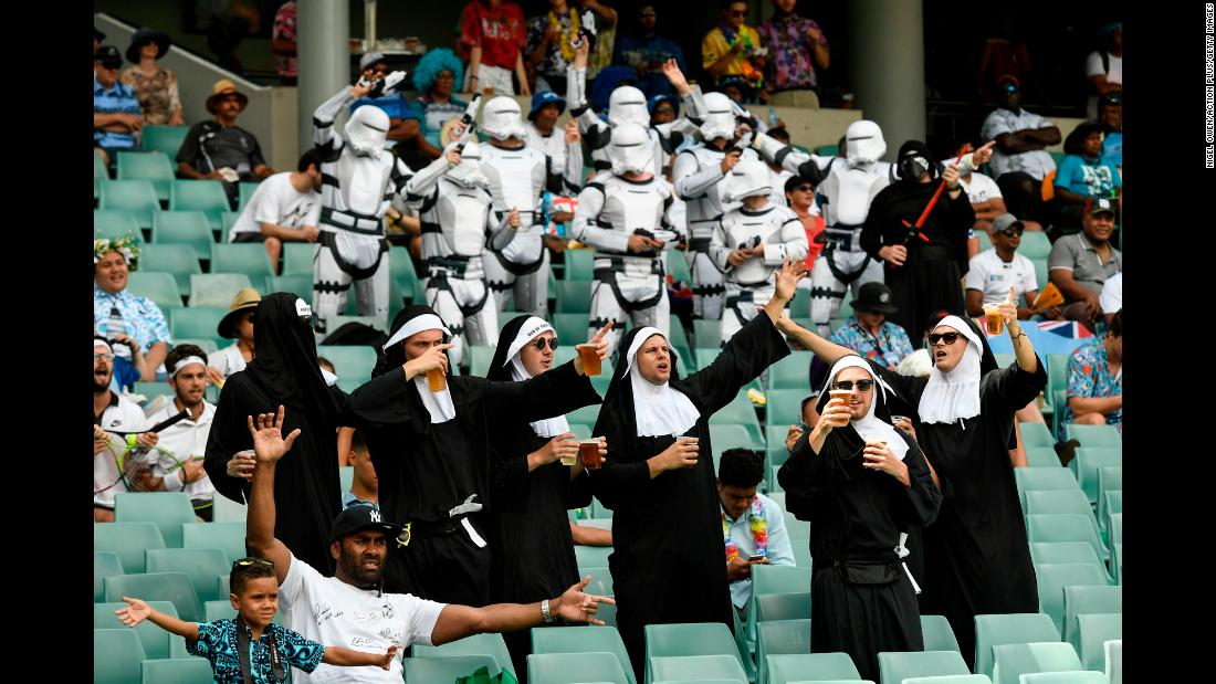 Some rugby fans wear costumes as they take in a Sydney Sevens match between England and Papua New Guinea on Saturday, January 27.
