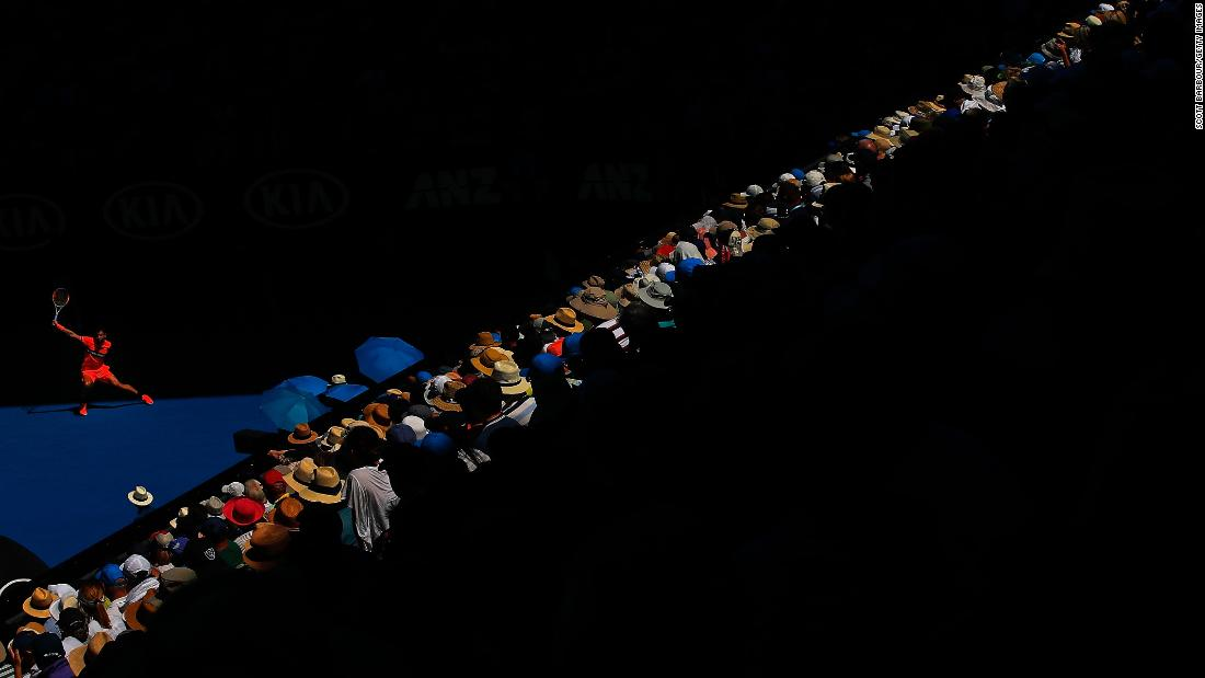 Fans watch Grigor Dimitrov play a backhand during an Australian Open quarterfinal match on Tuesday, January 23.