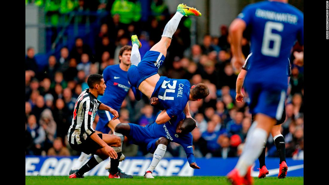 Chelsea defender Gary Cahill collides with teammate N'Golo Kante and goes airborne during an FA Cup match in London on Sunday, January 28.