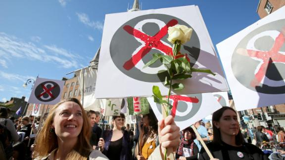 Protesters hold up placards against the Eighth Amendment in on September.