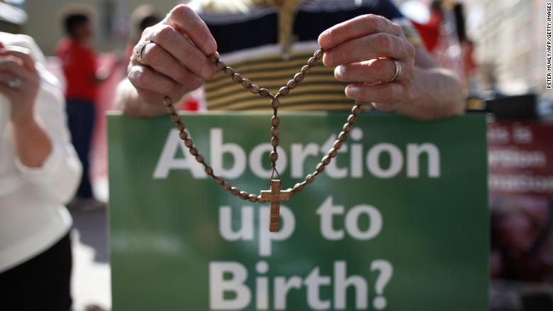 An anti-abortion protester holds rosary beads in Dublin at a rally on July 10, 2013.