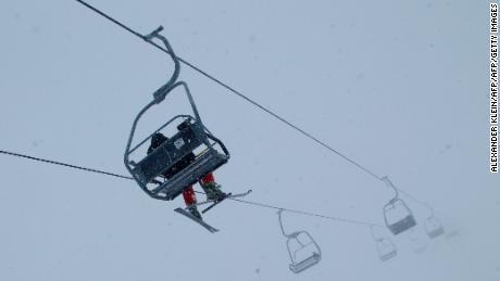 A skier uses a ski lifts during a snowy and foggy day with temperature of minus 10 degrees in the moutains of Schruns in the Montafon valley, Austrian Alps, on December 8, 2012. AFP PHOTO / ALEXANDER KLEIN        (Photo credit should read ALEXANDER KLEIN/AFP/Getty Images)