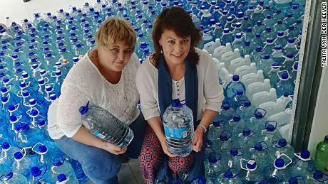Talita van der Heever (L) took to WhatsApp to try to alleviate a crisis that could see Cape Town run out of water in April.